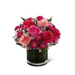 Base redonda con flores fuxias fuertes