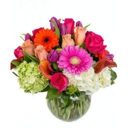 Burbuja de vidrio con flores variadas en colores fuertes