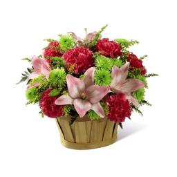 Canasta floral en tonos verdes y colorados
