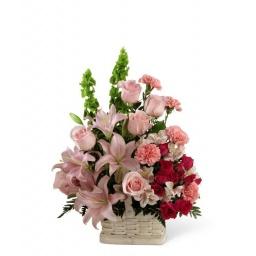 Canasta primaveral en tonos rosados