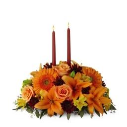 Centro de mesa en tonos naranja  (Consultar precio)