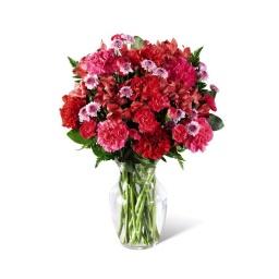 Florero con claveles, felpillas y astromelias