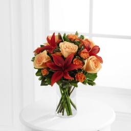 Florero con rosas y liliums