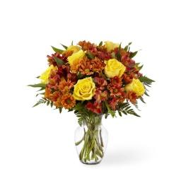 Florero con rosas, margaritas y astromelias