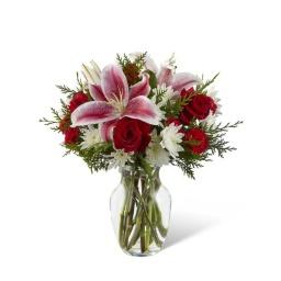 Florero vidrio con rosas liliums y felpillas